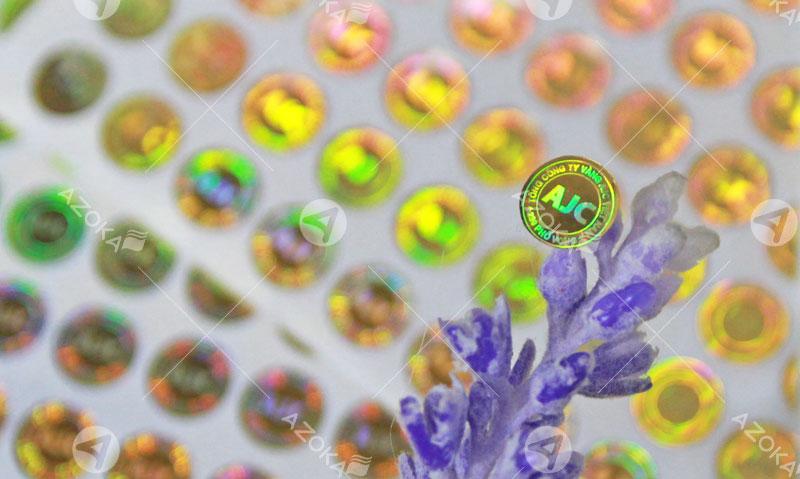 Mẫu tem 7 màu hologram tròn của AJS do Azoka thực hiện